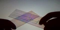 Pressure effects on light polarization through plastic